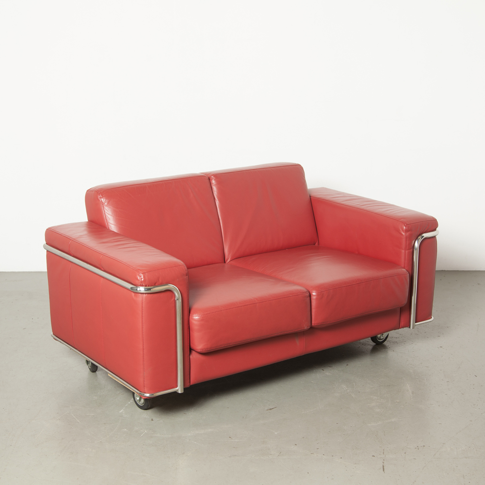 Red leather sofa couch Le Corbusier LC2 style inspired wheels chrome-plated tubular frame chrome tube two-seater midcentury modern design classic vintage retro secondhand
