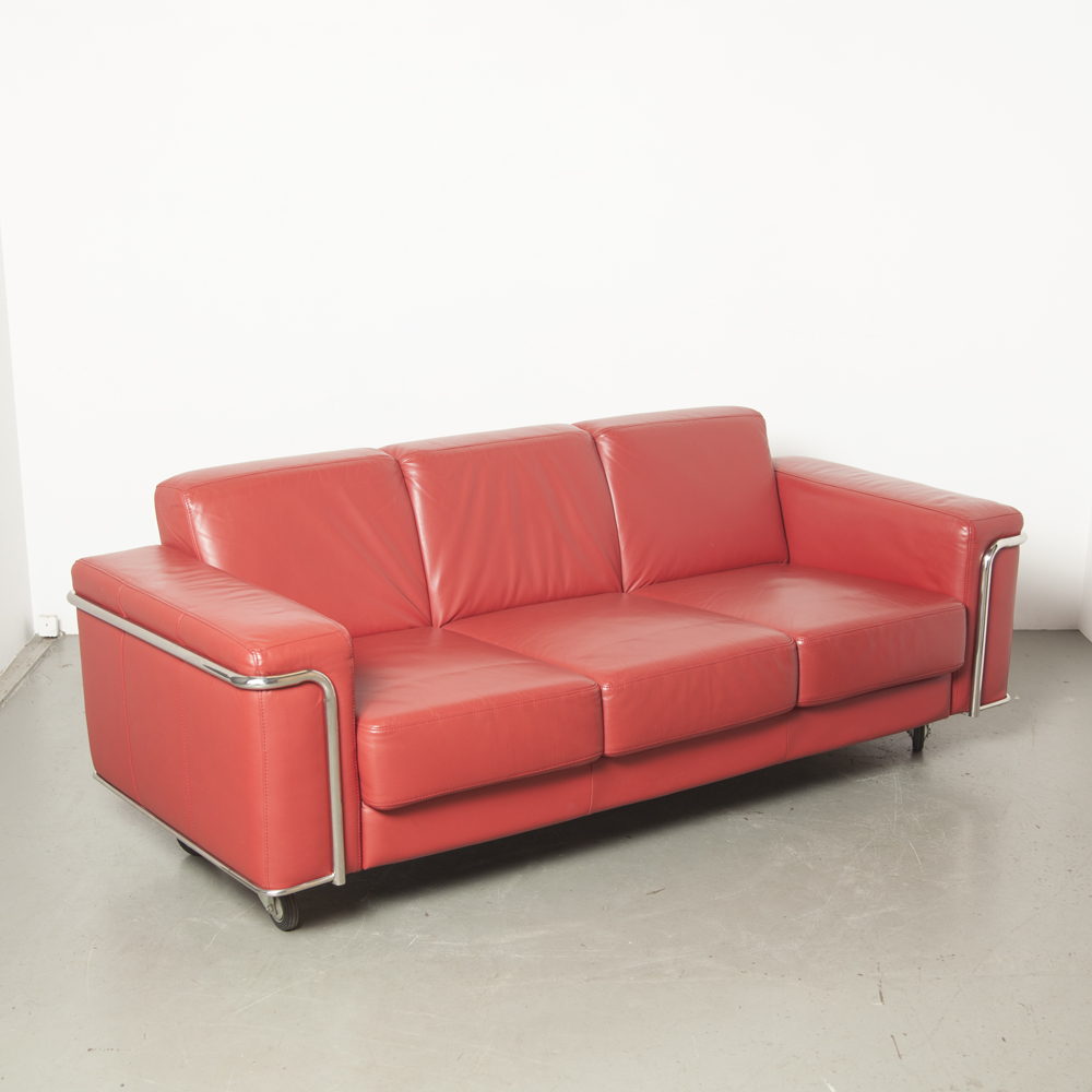 Red leather sofa couch Le Corbusier LC3 style inspired wheels chrome-plated tubular frame chrome tube three-seater midcentury modern design classic vintage retro secondhand