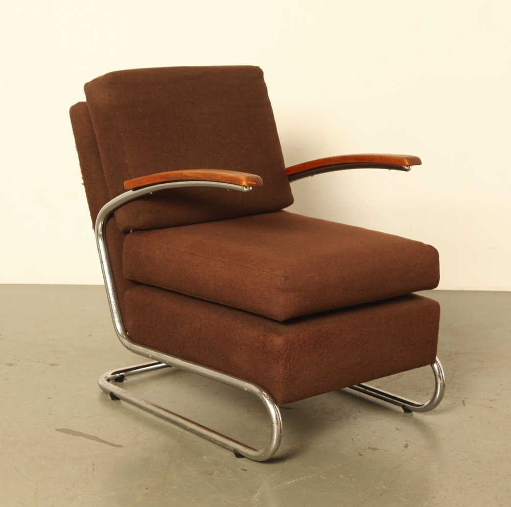 Tubular frame-armchair-low-seat-tubular-frame-armchair-brown-upholstery-wooden-armrests-curved-armrests-Marcel-Breuer-style-used-condition-vintage-mid-century