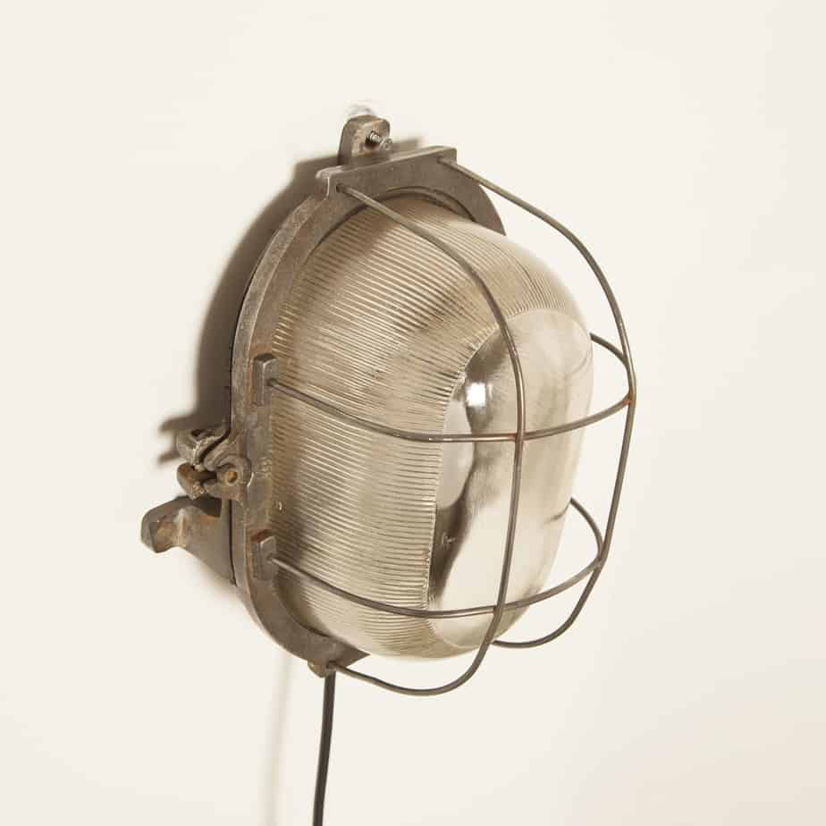 Wall Bulls-Eye oval splash-proof lamp Wandbull GDR Germany grey gray cage lamp cast iron housing thick glass shade light pressed glass vintage retro industrial