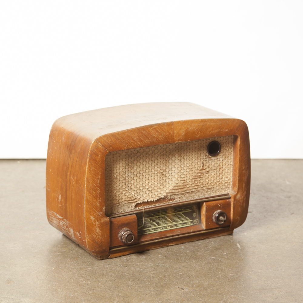 Tube Radio As-Is wood veneer cabinet decor piece original buttons back front cloth vintage retro 1940s 40s forties midcentury modern film TV props rental round curvaceous
