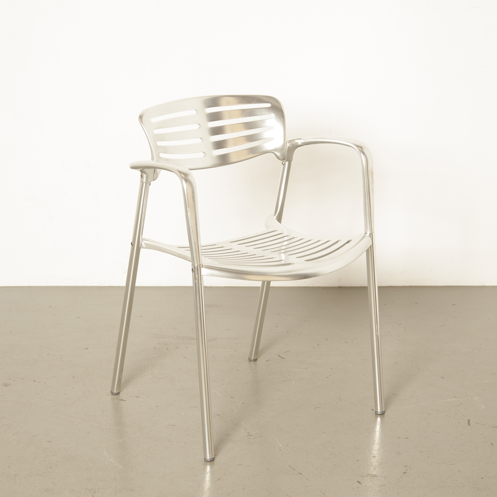 Toledo chair Jorge Pensi Amat-3 a3 Knoll Spain cast polished aluminum stacking silver tube legs cafe perforated ribs seat back modern vintage retro 80s 1980s eighties outside