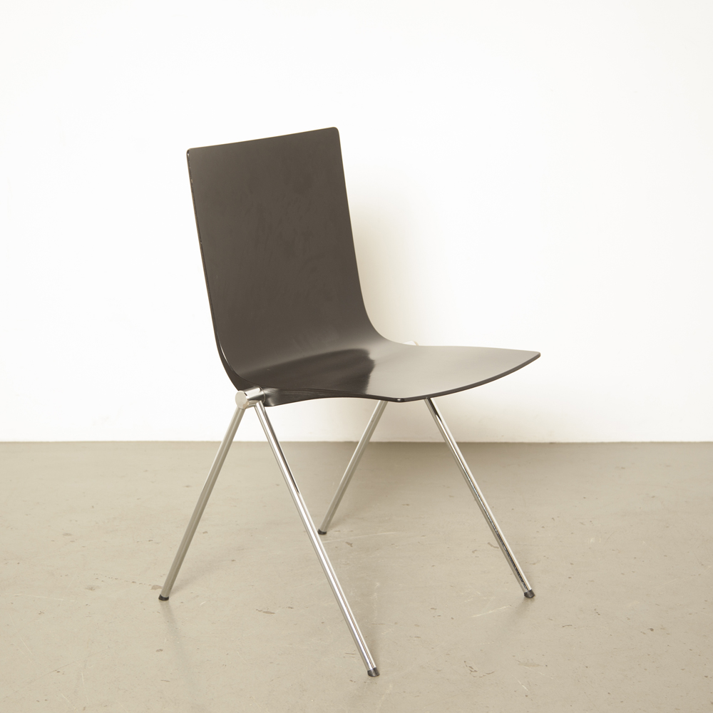 Black design chair hollow wood seat shell plywood chrome plated brass metal v-legs compass shape secondhand stacking
