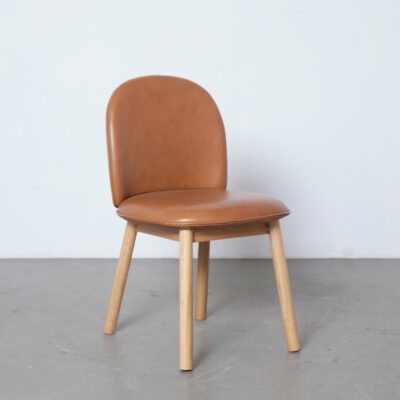 Ace dining chair Hans Hornemann Normann Copenhagen Ultra leather brandy lacquered oak legs frame PU foam welt piping flat pack light brown contemporary urban compact modern design Denmark