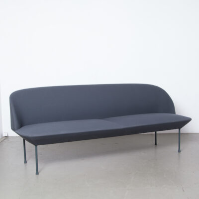 Oslo 3 seater sofa dark grey Anderssen Voll Muuto Norway Denmark Kvadrat fabric Steelcut inner steel frame Nozag springs powder-coated metal legs sculptural geometric lines slender airy chic light inviting appearance embracing rounded softness design couch seat current contemporary modern