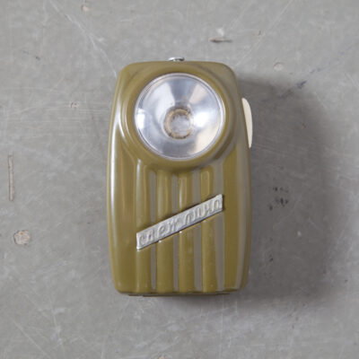 Super Cool Totally Useless vintage Pocket Flashlight no bulb battery tin painted box green red blue olive sage navy eastern block bloc planned economy soviet retro mid-century new out of the box old stock plastic lens scratched belt loop pocket clip