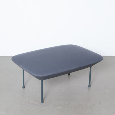 Oslo pouf bench hocker dark grey Anderssen Voll Muuto Norway Denmark Kvadrat fabric Steelcut inner steel frame Nozag springs powder-coated metal legs sculptural geometric lines slender airy chic light inviting appearance embracing rounded softness design seat foot stool ottoman footrest tuffet salon table current contemporary modern