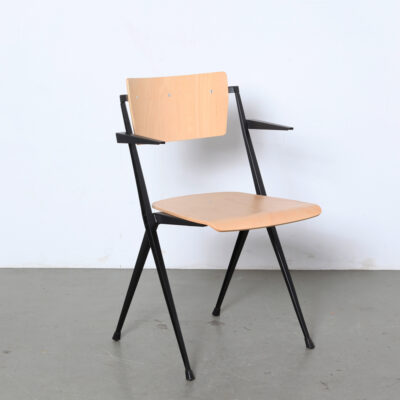 Wim-Rietveld-Pyramide-Chair-armrests-Ahrend-Cirkel-NL-1959-stackable-industrial-school-light-brown-plywood-seat-frame-Eindhoven-black