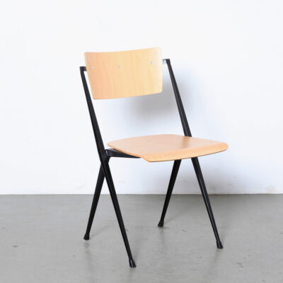Wim-Rietveld-Pyramide-Chair-Ahrend-Cirkel-NL-1959-stackable-industrial-school-light-brown-plywood-seat-black-frame-Eindhoven