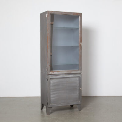 Bare Steel vertical cabinet glass shelves door solid bookcase display case etagere showcase exhibit cupboard storage closet medical hospital medicine pharmacist apothecary doctor lab style industrial vintage retro patina rust spots accents