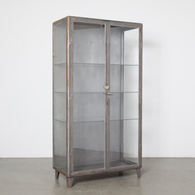 Bare Steel vertical double cabinet glass shelves door solid bookcase display case etagere showcase exhibit cupboard storage closet medical hospital medicine pharmacist apothecary doctor lab style industrial vintage retro patina rust spots accents