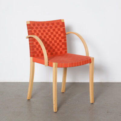 Nr 757 Chair Peter Maly Thonet Besonderes Besitzen woven webbing high quality workmanship craftsmanship solid beech frame finger joint bent plywood armrest Dining Vintage Modernist Postmodern Design clear finish blond seating red orange belt belting nineties 90s