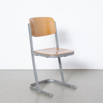 U-Vorm Stacking School Chair Conen u base bent shaped beech birch plywood seat back blond silver flattened pill shaped tube frame industrial vintage retro mid-century modern seventies 70s 1970s Dutch design