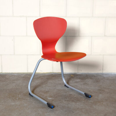 IKS chair Giovanni Baccolini Ilpospa Ilpo Design red rigid polyurethane shell springy grey tube steel base school seating education classroom stacking stackable hard-wearing child-proof contemporary modern nineties 90s 1990s