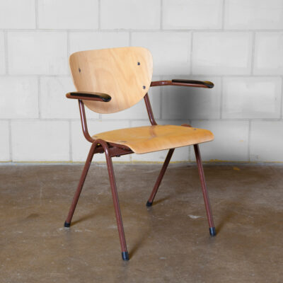 WANN vintage stacking school chair armrest bakelite stackable wooden plywood seat shaped curved bent steel tube frame rust red-brown powder-coated retro industrial dining cafe patina worn used sturdy indestructible 60s 1960s sixties seating